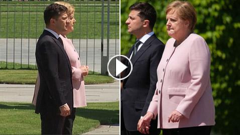 أنجيلا ميركل ترتجف وترتعش وتهتز بجانب الرئيس الأوكراني.. ما السبب؟!