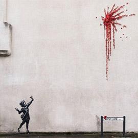 رصاصة من الزهور.. (غرافيتي) بانكسي الجديدة بمناسبة عيد الحب
