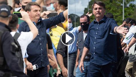 بالفيديو: رئيس البرازيل يخلع الكمامة ويستخف بفيروس كورونا مجددا!