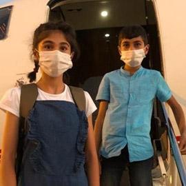 بالصور.. طفلان عراقيان يعودان بعد سنوات في كنف داعش